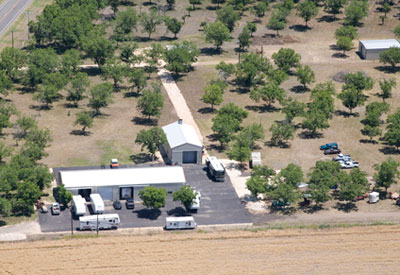 Aerial view of McQueeney Collision Inc. on 31 acres nested in the Texas Hill Country